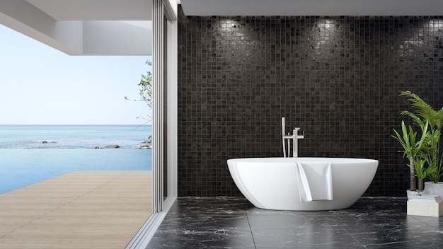 Baignoire sur sol en marbre noir de grande salle de bains dans maison moderne