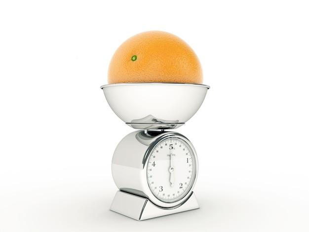 Balance de cuisine avec orange géante
