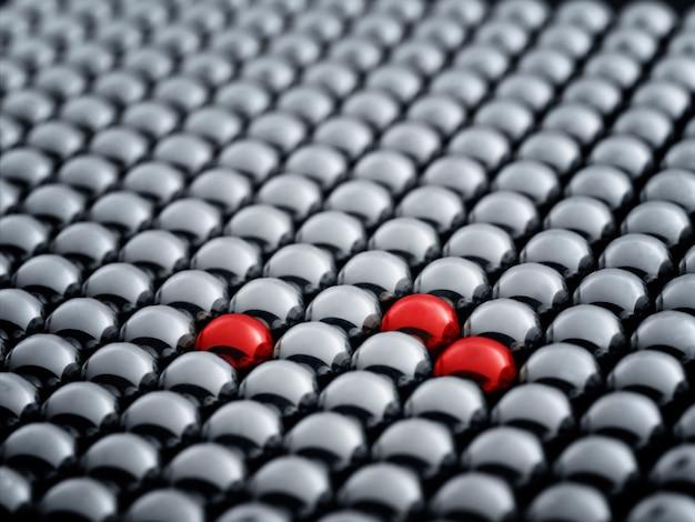 Balle rouge parmi les sphères blanches, se démarquant dans le concept de la foule