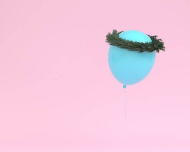 Ballon bleu flottant avec une couronne de plantes sur fond de couleur rose.