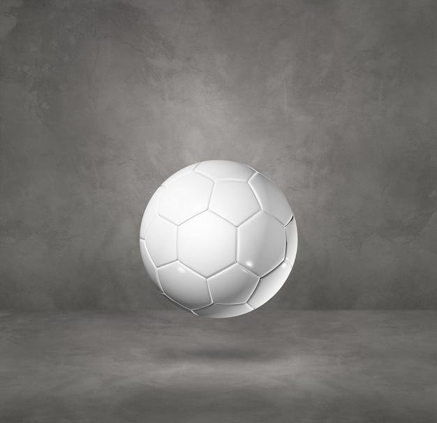 Ballon de football blanc isolé sur béton