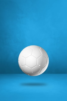 Ballon de football blanc isolé sur fond bleu studio. illustration 3d