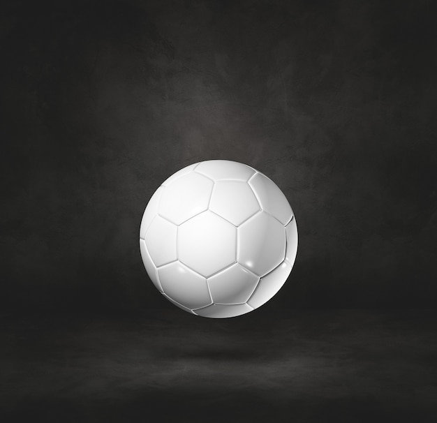 Ballon de football blanc isolé sur fond noir de studio. illustration 3d