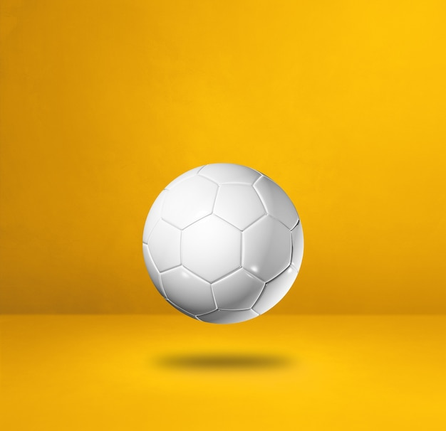 Ballon de football blanc isolé sur fond de studio jaune. illustration 3d