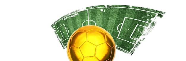 Ballon de football doré avec aire de jeux verte