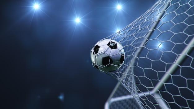 Un ballon de football a volé dans le but.