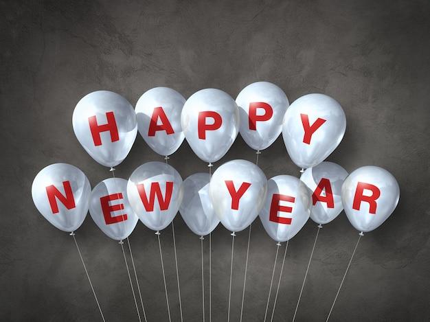 Ballons à air blanc bonne année sur un béton foncé