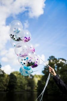 Ballons transparents extérieurs avec des confettis à l'intérieur