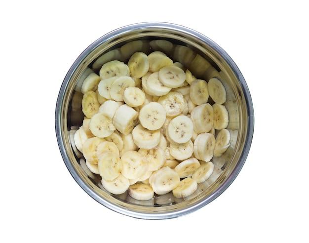 Banane cavendish dans un bocal en acier inoxydable isolé sur fond blanc.