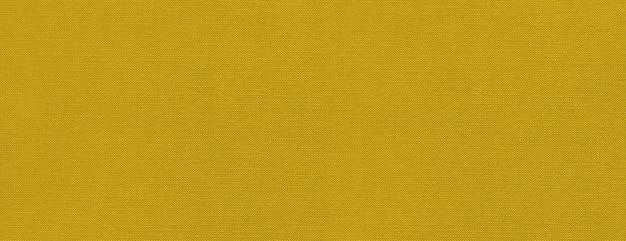 Bannière de fond de texture de toile jaune. papier peint en tissu propre