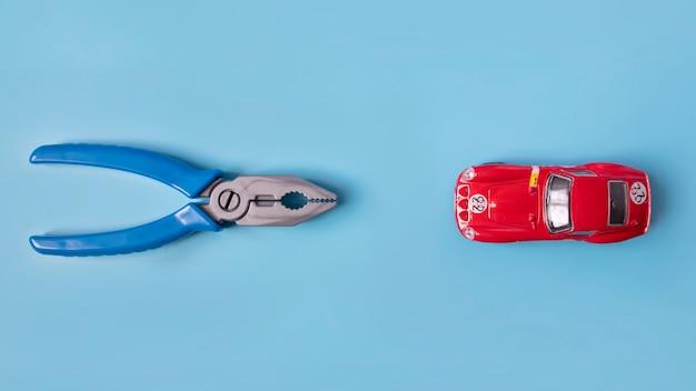Bannière, plascomps et une petite voiture sur un bleu