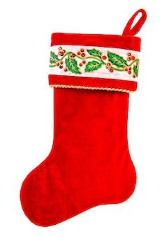 Bas de noël. chaussette rouge pour cadeaux isolé sur fond blanc