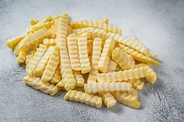 Bâtonnets de pommes de terre frites froides surgelées