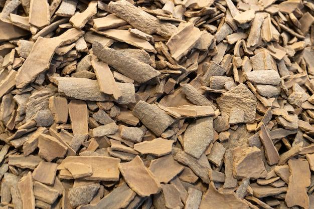 Bâtons de cannelle cassés spice closeup background texture des bâtons de cannelle. vue de dessus