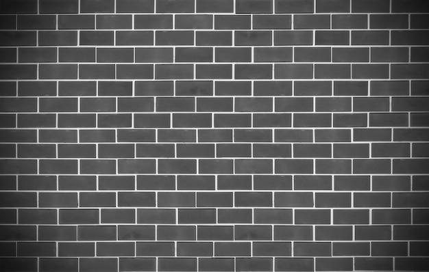 Beau design texturé de vieux fond de mur de briques noires.