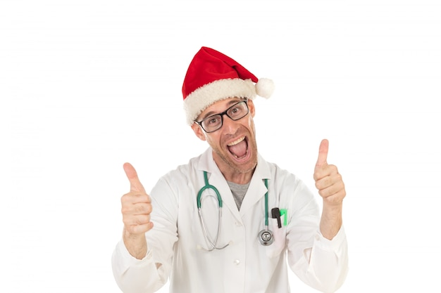 Beau docteur avec chapeau de noël coiffé d'un chapeau de noël