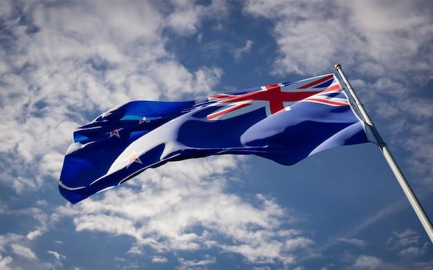 Beau drapeau national de la nouvelle-zélande flottant sur le ciel bleu