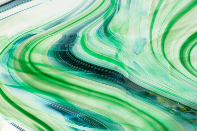 Beau fond abstrait multicolore de vitrail vert avec des lignes.