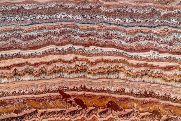 Beau fond de marbre rouge abstrait naturel