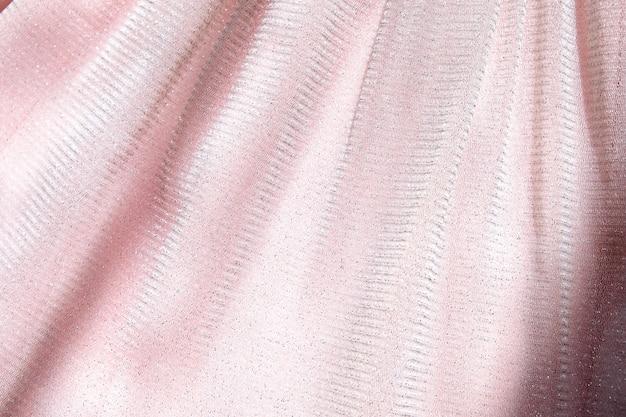 Beau fond rose délicat. texture de close-up de tissu moelleux brillant maille