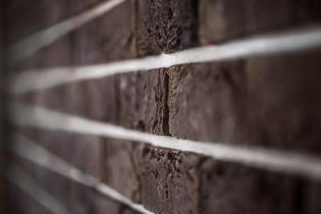 Beau mur de briques, gros plan brun foncé