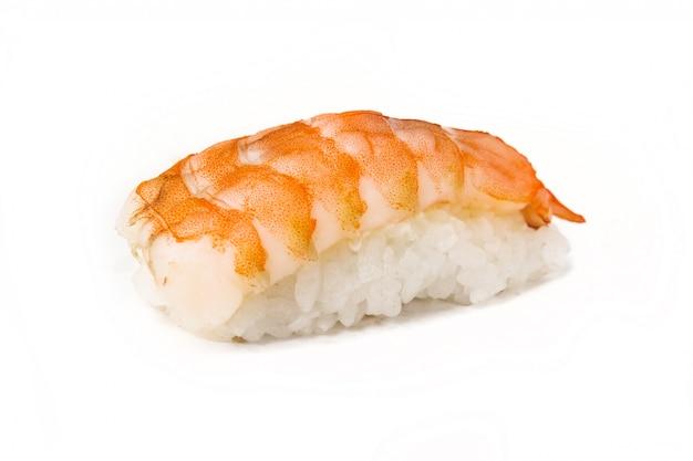 Beau plat de cuisine japonaise sur une plaque blanche avec du riz et du poisson