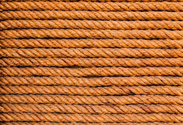 Beaucoup de fond et de la texture de la corde brune horizontale pour la toile de fond de la publicité en ligne.