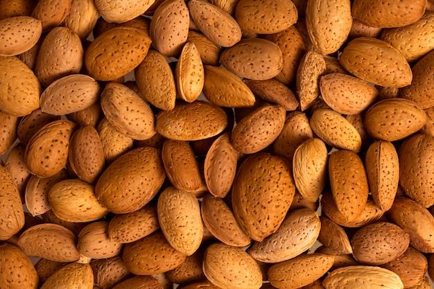 Beaucoup de gros plan de noix. amandes non pelées. fond naturel pour une alimentation saine concept