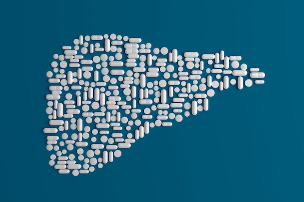 Beaucoup de pilules dispersées sur un bleu en forme de foie