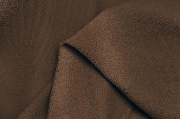 Beauté de gros plan de fond de texture de soie de tissu marron foncé