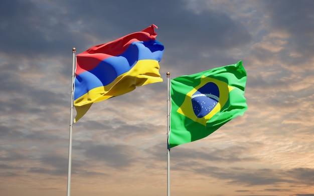 Beaux drapeaux d'état national du brésil et de l'arménie ensemble sur ciel bleu