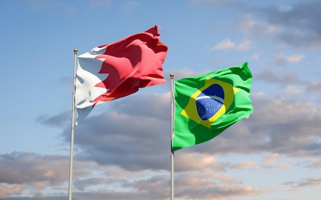Beaux drapeaux d'état national du brésil et de bahreïn ensemble sur ciel bleu