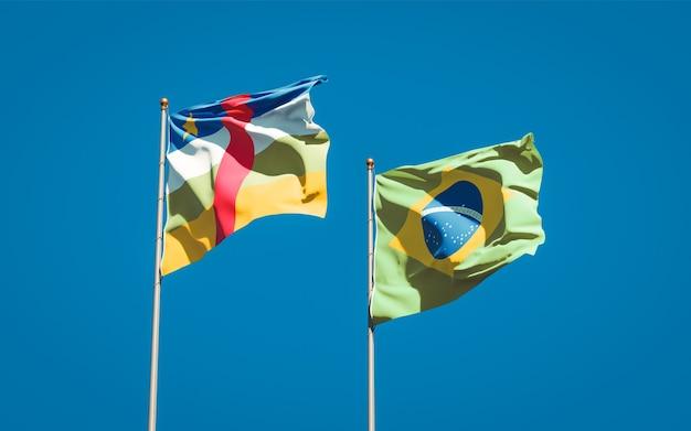 Beaux drapeaux d'état national du brésil et de la rca république centrafricaine ensemble sur ciel bleu