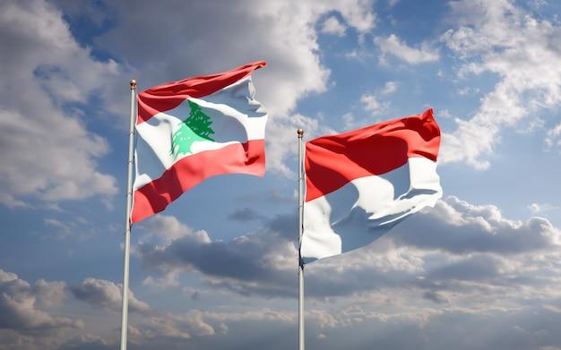 Beaux drapeaux d'état national du liban et de l'indonésie ensemble sur ciel bleu