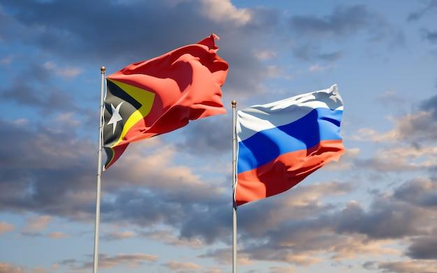 Beaux drapeaux d'état national du timor oriental et de la russie ensemble sur le ciel bleu. illustration 3d