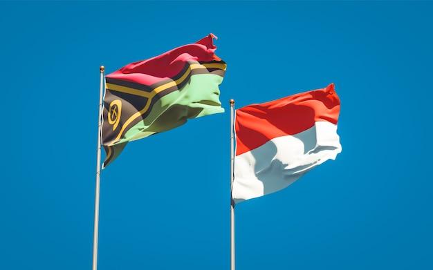 Beaux drapeaux d'état national du vanuatu et de l'indonésie ensemble sur ciel bleu