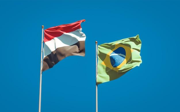 Beaux drapeaux d'état national du yémen et du brésil ensemble sur ciel bleu