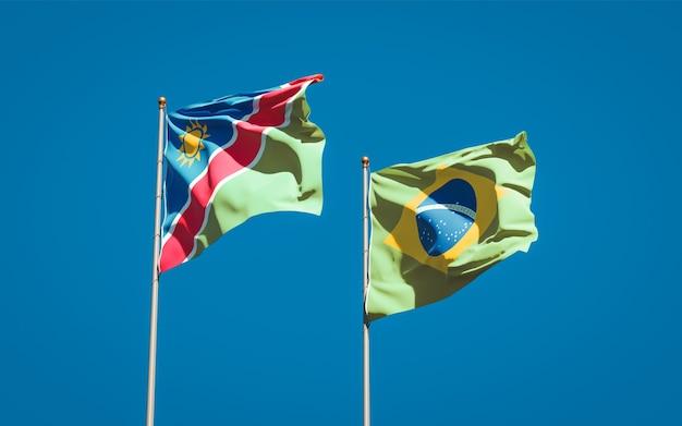 Beaux drapeaux d'état national de la namibie et du brésil ensemble sur ciel bleu