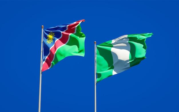 Beaux drapeaux d'état national de la namibie et du nigéria ensemble sur ciel bleu