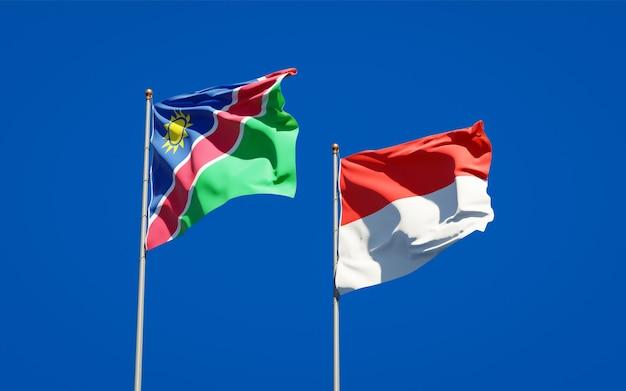 Beaux drapeaux de l'état national de la namibie et de l'indonésie ensemble sur ciel bleu