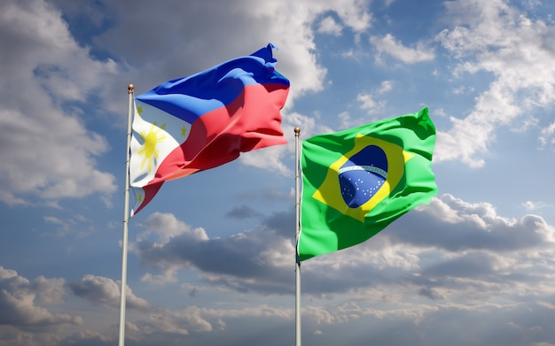 Beaux drapeaux d'état national des philippines et du brésil ensemble sur ciel bleu