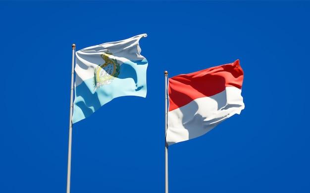 Beaux drapeaux d'état national de saint-marin et de l'indonésie ensemble sur ciel bleu