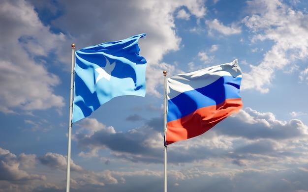 Beaux drapeaux d'état national de la somalie et de la russie ensemble sur le ciel bleu. illustration 3d