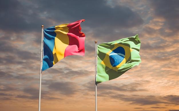 Beaux drapeaux des états nationaux du brésil et du tchad ensemble sur ciel bleu