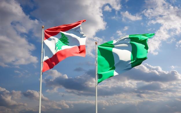 Beaux drapeaux des états nationaux du liban et du nigéria ensemble sur ciel bleu
