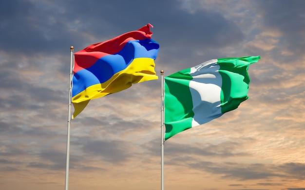 Beaux drapeaux des états nationaux du nigéria et de l'arménie ensemble sur ciel bleu