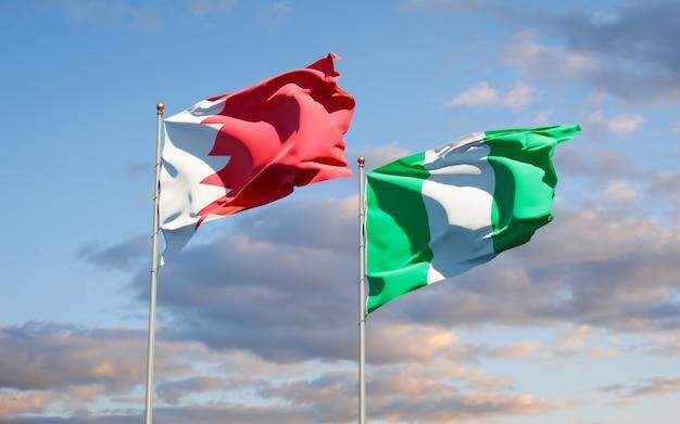 Beaux drapeaux des états nationaux du nigéria et de bahreïn ensemble sur ciel bleu