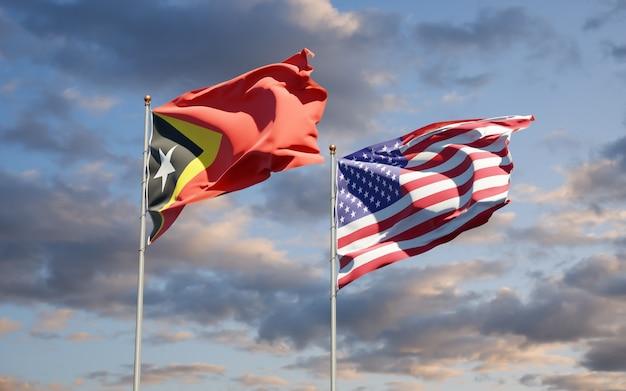 Beaux drapeaux des états nationaux du timor oriental et des états-unis ensemble