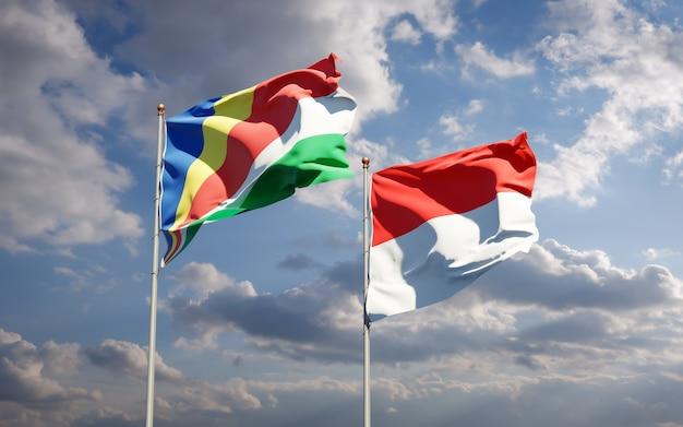 Beaux drapeaux des états nationaux des seychelles et de l'indonésie ensemble sur ciel bleu