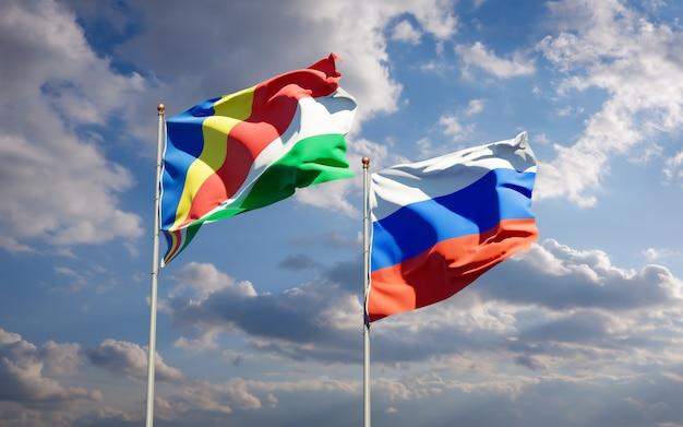 Beaux drapeaux des états nationaux des seychelles et de la russie ensemble sur le ciel bleu. illustration 3d
